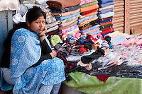 Kathmandu, Nepal.  Nepali Woman Selling Towels and Clothes, Downtown Sidewalk Market.