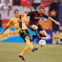 The Galaxy's Alejandro Moreno and the MetroStars' Chris Leitch go for the ball. The NY/NJ MetroStars defeated the LA Galaxy 3 to 0 during MLS action at Giant's Stadium, East Rutherford, NJ, on August 8, 2004.