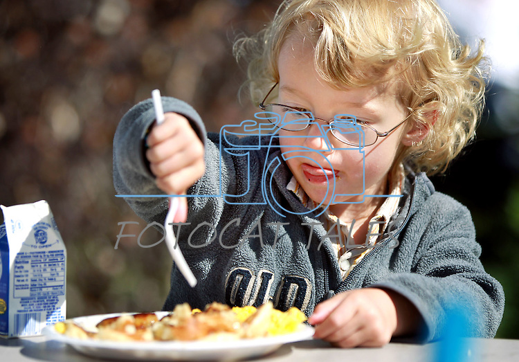 Bowdoin Forman, 3, eats at the Carson City Library Summer Reading Program Pancake Breakfast Kick-Off on Saturday morning. .Photo by Cathleen Allison/Nevada Photo Source