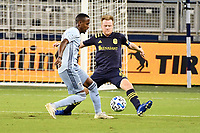 KANSAS CITY, KS - OCTOBER 11: Gadi Kinda #17 of Sporting Kansas City challenged by Dax McCarty #6 of Nashville SC during a game between Nashville SC and Sporting Kansas City at Children's Mercy Park on October 11, 2020 in Kansas City, Kansas.