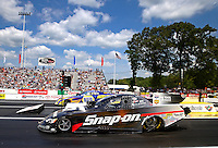Jun. 2, 2013; Englishtown, NJ, USA: NHRA funny car driver Cruz Pedregon (near lane) races alongside Ron Capps during the Summer Nationals at Raceway Park. Mandatory Credit: Mark J. Rebilas-