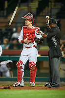 Scottsdale Scorpions Taylor Ward (9), of the Los Angeles Angels of Anaheim organization, gets a new ball from umpire Ramon De Jesus during a game against the Mesa Solar Sox on October 17, 2016 at Scottsdale Stadium in Scottsdale, Arizona.  Mesa defeated Scottsdale 12-2.  (Mike Janes/Four Seam Images)