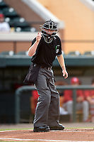 Umpire Ryan Doherty makes a call during a game between the Palm Beach Cardinals and Lakeland Flying Tigers on April 13, 2015 at Joker Marchant Stadium in Lakeland, Florida.  Palm Beach defeated Lakeland 4-0.  (Mike Janes/Four Seam Images)