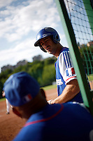 24 June 2011: Jerome Rousseau of Team France. Illustration of a photographic essay called Life in the dugout, during France 8-5 win over UCLA Alumni, at the 2011 Prague Baseball Week, in Prague, Czech Republic.
