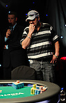 Daniel Clemente seems worried after seeing he is behind on the flop.  He was eliminated in 3rd. place.