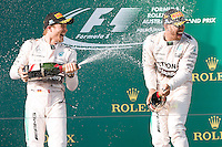 March 15, 2015: Lewis Hamilton (GBR) #44 (1st) and Nico Rosberg (DEU) #6 (2nd) spray champagne on the podium at the 2015 Australian Formula One Grand Prix at Albert Park, Melbourne, Australia. Photo Sydney Low
