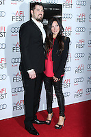 """HOLLYWOOD, CA - NOVEMBER 12: Marcus Luttrell, Melanie Juneau at the AFI FEST 2013 - """"Lone Survivor"""" Premiere held at TCL Chinese Theatre on November 12, 2013 in Hollywood, California. (Photo by David Acosta/Celebrity Monitor)"""
