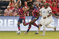 KANSAS CITY, KS - JULY 15: Daryl Dike #11 of the United States moves with the ball during a game between Martinique and USMNT at Children's Mercy Park on July 15, 2021 in Kansas City, Kansas.
