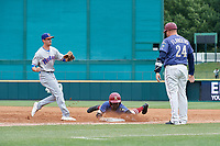 Frisco RoughRiders Michael De Leon (54) dives back to the bag as first baseman Luke Persico (8) and base coach Brian Flanders (24) look on during a Texas League game against the Frisco RoughRiders on May 21, 2019 at Dr Pepper Ballpark in Frisco, Texas.  (Mike Augustin/Four Seam Images)
