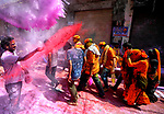 Pictured: Hindu devotees are seen celebrating with colourful powders during this years Lathmar Holi Festival in Uttar Pradesh, India.<br /> <br /> Holi, often offered to as the 'festival of colours is one of the biggest festivals in India celebrated by thousands of devotees.<br /> <br /> Please byline: Avishek Das/Solent News<br /> <br /> © Avishek Das/Solent News & Photo Agency<br /> UK +44 (0) 2380 458800