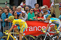Yellow jersey wearer, Alberto Contador, riding towards the finish line, and his third Tour de France title. Paris, France, 25th July 2010