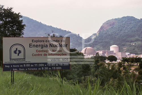 "Angra dos Reis, Rio de Janeiro, Brazil. Sign outside the Angra 2 nuclear power station; ""Explore o mundo da Energia Nuclear"" - ""Explore the world of nuclear energy"". Visitor centre."