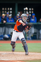 Virginia Cavaliers catcher Matt Thaiss (21) makes a throw to first base against the Seton Hall Pirates at The Ripken Experience on February 28, 2015 in Myrtle Beach, South Carolina.  The Cavaliers defeated the Pirates 4-1.  (Brian Westerholt/Four Seam Images)