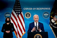 U.S. Vice President Kamala Harris, left, listens as U.S. President Joe Biden speaks on the state of the Covid-19 vaccine in the South Court Auditorium of the White House in Washington, D.C., U.S., on Monday, March 29, 2021. <br /> CAP/MPI/RS<br /> ©RS/MPI/Capital Pictures