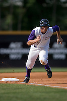 Brent Morel #21 of the Winston-Salem Dash scores from third base on a sacrafice fly at Wake Forest Baseball Park May 10, 2009 in Winston-Salem, North Carolina. (Photo by Brian Westerholt / Four Seam Images)