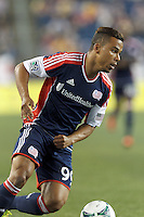 New England Revolution substitute forward Charlie Davies (99) on the attack.  In a Major League Soccer (MLS) match, the New England Revolution (dark blue) defeated Philadelphia Union (light blue), 5-1, at Gillette Stadium on August 25, 2013.