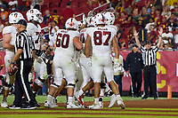 LOS ANGELES, CA - SEPTEMBER 11: The Stanford Cardinal offense celebrate a touchdown run by Isaiah Sanders #0 during a game between University of Southern California and Stanford Football at Los Angeles Memorial Coliseum on September 11, 2021 in Los Angeles, California.