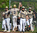 BEACON FALLS, CT 050621JS09—Woodland's Jayden Tomasella  (3) is congratulated by teammates after coming in to score a run during their key NVL match up with Holy Cross Thursday at Woodland Regional High School.<br /> Jim Shannon Republican American