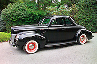 A black 1940 Ford Deluxe automobile