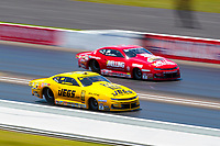 Jul 12, 2020; Clermont, Indiana, USA; NHRA pro stock driver Jeg Coughlin Jr (near) alongside teammate Erica Enders during the E3 Spark Plugs Nationals at Lucas Oil Raceway. This is the first race back for NHRA since the start of the COVID-19 global pandemic. Mandatory Credit: Mark J. Rebilas-USA TODAY Sports