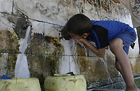 """Palestinian child Osama Jergeon drink from a water treatment plant in the city Khanions southern Gaza Strip.<br />   the water station established by the United Nations Relief May,23,2007.""""photo by Fady Adwan"""""""