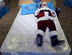 "(EYELEVEL)--On Sat Nov 19,2005--eyelevel1119--""Sleeping Santa""--Brunswick Square Mall, East Brunswick. (MARK R. SULLIVAN/HNT CHIEF PHOTOGRAPHER)"