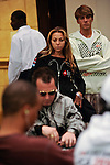 """PS Team Pro Veronica Dabul """"rails"""" Phil Ivey's table during level 8 on Day 1B."""