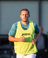 Gylfi Sigurosson of Swansea City warms up during the 2017/18 Pre Season Friendly match between Barnet and Swansea City at The Hive, London, England on 12 July 2017. Photo by Andy Rowland.