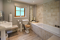 BNPS.co.uk (01202) 558833. <br /> Pic: Bidwells/BNPS<br /> <br /> Pictured: Bathroom.<br /> <br /> Better than a gravy boat...<br /> <br /> A striking country house built by a bishop as a wedding gift for his son is on the market for offers over £2m.<br /> <br /> Dunbeg House sits in an incredible position on the bank of a loch with stunning panoramic water and mountain views.<br /> <br /> The impressive property not only includes the five-bedroom main house, but also a two-bedroom cottage that has been run as a successful holiday let and over four acres of woodland garden.