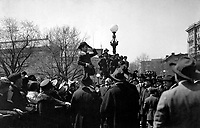 """Charlie Chaplin, comedy star of the """"movies"""", making his first speech for the third Liberty Loan in front of the State, War and Navy Bldg, Washington D.C., on first anniversary of U.S. entry into war.  April 6, 1918.  Lt. Edmond deBerri.   (Army)<br />NARA FILE #:  111-SC-7268<br />WAR & CONFLICT BOOK #:  516"""