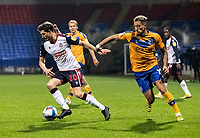 Bolton Wanderers' Shaun Miller breaks away from Mansfield Town's Kellan Gordon (right) <br /> <br /> Photographer Andrew Kearns/CameraSport<br /> <br /> The EFL Sky Bet League Two - Bolton Wanderers v Mansfield Town - Tuesday 3rd November 2020 - University of Bolton Stadium - Bolton<br /> <br /> World Copyright © 2020 CameraSport. All rights reserved. 43 Linden Ave. Countesthorpe. Leicester. England. LE8 5PG - Tel: +44 (0) 116 277 4147 - admin@camerasport.com - www.camerasport.com