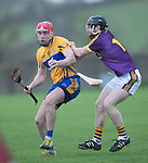 Niall Deasy of Clare in action against James Breen of Wexford during the Jack Lynch Memorial game at Tulla. Photograph by John Kelly.