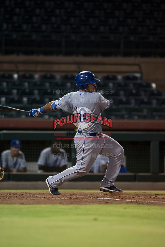 AZL Royals catcher Paul Mondesi (18) follows through on his swing during an Arizona League game against the AZL Giants Black at Scottsdale Stadium on August 7, 2018 in Scottsdale, Arizona. The AZL Giants Black defeated the AZL Royals by a score of 2-1. (Zachary Lucy/Four Seam Images)
