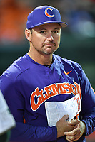 Head coach Monte Lee (18) of the Clemson Tigers meets with umpires before a game against the Michigan State Spartans on Wednesday, March 8, 2017, at Fluor Field at the West End in Greenville, South Carolina. Clemson won, 9-2. (Tom Priddy/Four Seam Images)