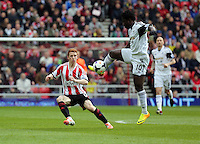 Pictured L-R: Jack Colback of Sunderland has the ball taken by Wilfried Bony of Swansea. Sunday 11 May 2014<br /> Re: Barclay's Premier League, Sunderland v Swansea City FC at the Stadium of Light, Sunderland, UK.
