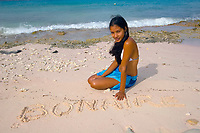 Bonaire - sand graffiti, young woman on the beach, Bonaire, Netherlands Antilles, Caribbean Sea, Atlantic Ocean