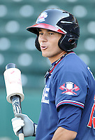 Outfielder Ramon Flores (25) of the Rome Braves, Class A affiliate of the Atlanta Braves, in a game against the Greenville Drive April 12, 2010, at Fluor Field at the West End in Greenville, S.C. Photo by: Tom Priddy/Four Seam Images