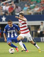 Alejandro Bedoya #20 of the USMNT battles for the ball against Roger Rojas #21 of Honduras on July 24, 2013at Dallas Cowboys Stadium in Arlington, TX. USMNT won 3-1.