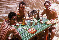 """Mascara Area, Algeria, Summer 1961. Typical French Fort for a small harka unit. This unit counted 48 """"harkis"""", Arab origin, fighting along the French troops. The table for the Under Officers from left to right: Sargents Derkaoui (Harki) and Schwartz and Roussel are serving their time."""