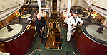 Pictured:  Left/right: Volunteers John Phelps, Engineer and Graham Martin, Chief Engineer, perform maintenance in the engine room of Southampton's Steamship Shieldhall as the team put Shieldhall to bed for the winter.<br /> <br /> The steamship marked her 65th birthday this summer, but was unable to celebrate as planned due to the pandemic. However, behind-the-scenes work on Shieldhall means that Southampton's heritage steamship is in excellent condition, with volunteers looking forward to a full 2021 sailing programme. <br /> <br /> Shieldhall last sailed in September 2019, and plans to sail again with passengers on board in May 2021. <br /> <br /> The ship provides a working example of steamship machinery both above and below deck, typical of the cargo and passenger ships that plied the oceans of the world from the 1870s until the mid 1960s, by which time they were all but extinct.<br /> <br /> Special trips held over from 2020 will be staged next year, including a cruise to celebrate the 200th anniversary of the first steamship to leave Southampton, the Prince of Cobourg, in 1820. <br /> <br /> Initially, a limited number of tickets will be available as Shieldhall introduces COVID-compliant measures on board during the autumn and winter. A Government Heritage Emergency Grant awarded during the summer has assisted Shieldhall's volunteers in carrying out essential maintenance works on the ship. <br /> <br /> © Simon Czapp/Solent News & Photo Agency<br /> UK +44 (0) 2380 458800