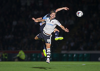 Tom Cairney of Fulham wins the ball in the air during the Capital One Cup match between Wycombe Wanderers and Fulham at Adams Park, High Wycombe, England on 11 August 2015. Photo by Andy Rowland.