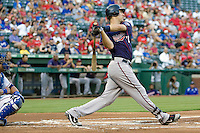 Minnesota Twins catcher Joe Mauer #7 follows through on a first inning home during a Major League Baseball game against the Texas Rangers at the Rangers Ballpark in Arlington, Texas on July 27, 2011. The first inning home run was Mauer's first home run of the season and helped Minnesota defeat Texas 7-2.  (Andrew Woolley/Four Seam Images)