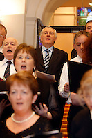 18/12/07 Taoiseach Bertie Ahern singing with a choir at the annual christmas carol singing at Government Buildings, Dublin.. Picture:Arthur Carron/Collins