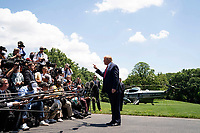 President Donald J. Trump talks to reporters on the South Lawn of the White House Wednesday, June 26, 2019, prior to boarding Marine One to begin his trip to Japan. (Official White House Photo by Joyce N. Boghosian)