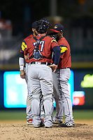 Toledo Mud Hens catcher Bobby Wilson (37) has a meeting on the mound with relief pitcher Jose Cisnero (32) during the game against the Charlotte Knights at BB&T BallPark on April 23, 2019 in Charlotte, North Carolina. The Knights defeated the Mud Hens 11-9 in 10 innings. (Brian Westerholt/Four Seam Images)
