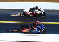 Mar 19, 2017; Gainesville , FL, USA; NHRA pro stock motorcycle rider Angie Smith (near) races alongside Steve Johnson during the Gatornationals at Gainesville Raceway. Mandatory Credit: Mark J. Rebilas-USA TODAY Sports