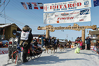 Heidi Sutter runs into the chute at the finish line in Nome on Saturday March 21, 2015 during Iditarod 2015.  <br /> <br /> (C) Jeff Schultz/SchultzPhoto.com - ALL RIGHTS RESERVED<br />  DUPLICATION  PROHIBITED  WITHOUT  PERMISSION
