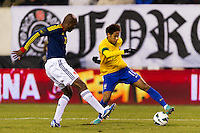 Neymar (11) of Brazil is defended by Aquivaldo Mosquera (22) of Colombia. Brazil (BRA) and Colombia (COL) played to a 1-1 tie during international friendly at MetLife Stadium in East Rutherford, NJ, on November 14, 2012.