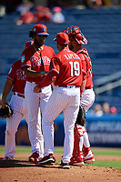 Philadelphia Phillies manager Gabe Kapler (19) takes the baseball from starting pitcher Adonis Medina (77) as he makes a pitching change during a Grapefruit League Spring Training game against the Baltimore Orioles on February 28, 2019 at Spectrum Field in Clearwater, Florida.  Orioles tied the Phillies 5-5.  (Mike Janes/Four Seam Images)