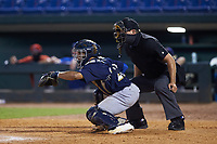 Catcher Harry Ford (20) of North Cobb HS in Kennesaw, GA playing for the Milwaukee Brewers scout team sets a target as home plate umpire CJ Burdette looks on during the East Coast Pro Showcase at the Hoover Met Complex on August 4, 2020 in Hoover, AL. (Brian Westerholt/Four Seam Images)